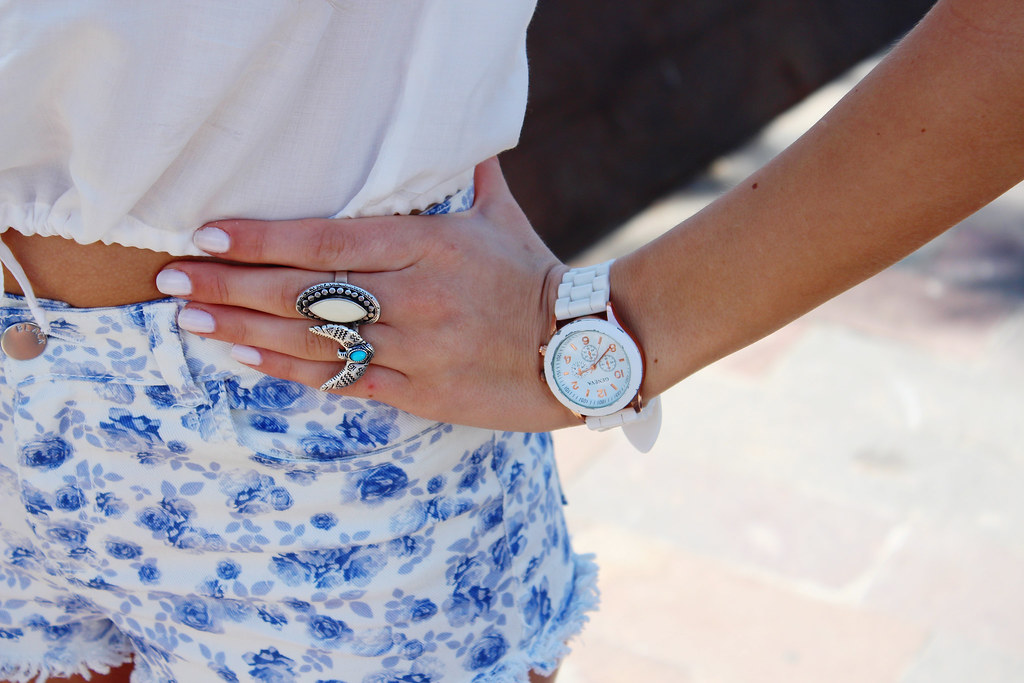 What I was wearing on a vacation while in Canary islands- a white crop top from H&M Loves Music collection, white shorts with blue floral print on them as well from H&M Loves Music, white Geneva watch from Ebay, blue Primark earrings