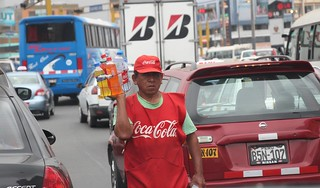 Coke street vendor on street in Lima