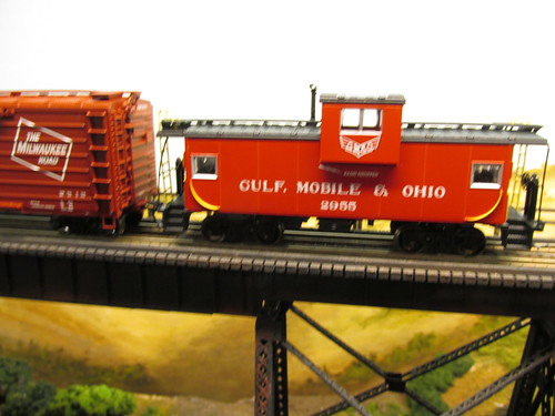 A late 1960's era Gulf, Mobile & Ohio freight train crossing the tall steel trestle. by Eddie from Chicago