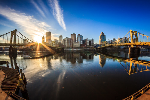 city morning bridge sky urban sun fall beautiful clouds sunrise canon buildings reflections river dawn downtown pittsburgh cityscape fisheye explore flare rays riverwalk sunflare alleghenyriver burgh highmark cityofbridges clementebridge explored ussteelbuilding pittsburghphotography jaimedillenseibel pittsburghexplored