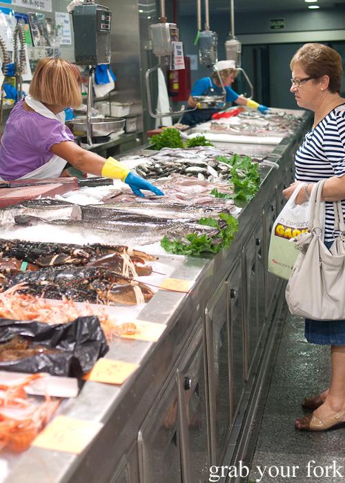 Buying fish at Plaza de Lugo Fish Market in A Coruna, Galicia, Spain