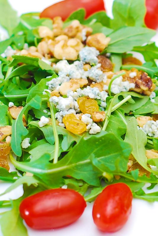 Arugula salad with walnuts, golden raisins, and Gorgonzola cheese, salad recipes, appetizers, snacks, vegetarian recipe, nuts, gluten free salads, gluten free recipe