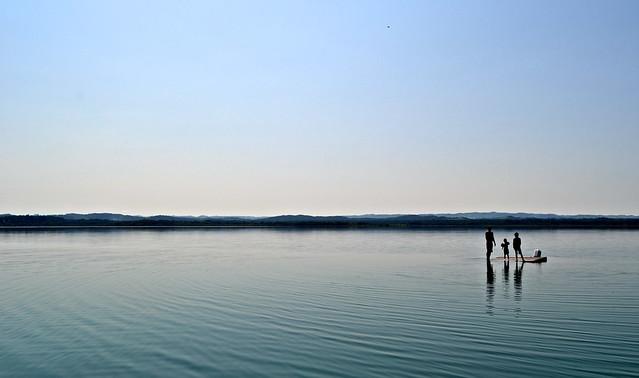 kids swimming in peten itza lake guatemala el remate