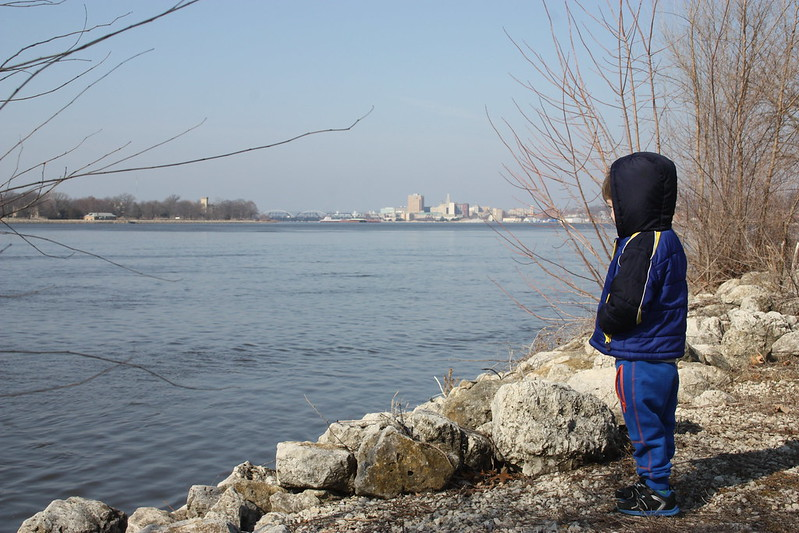 Darian looking out on the Mississippi, Davenport, Iowa in the back ground