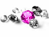 Pink gemstone in focus among colorless gemstones by [ 117 Imagery ]