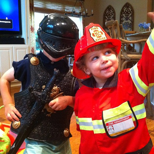 My brave firefighter and knight are protecting me from the storm.