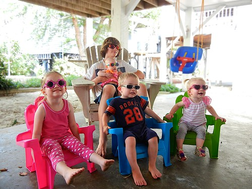 Cousins wearing sunglasses at the beach house. :)