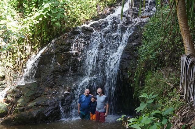 Three generations of Hacker men in waterfall