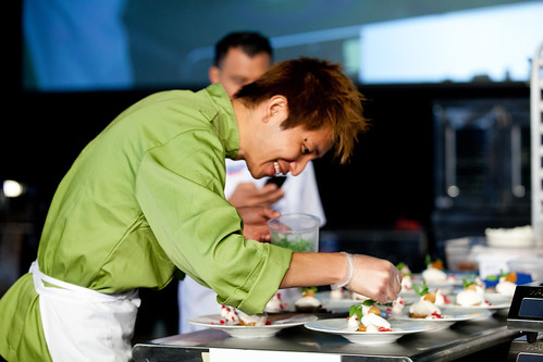 Pastry Chef Yoshikazu Kizu of Ritz Carlton Orlando plating at the Pastry Competition