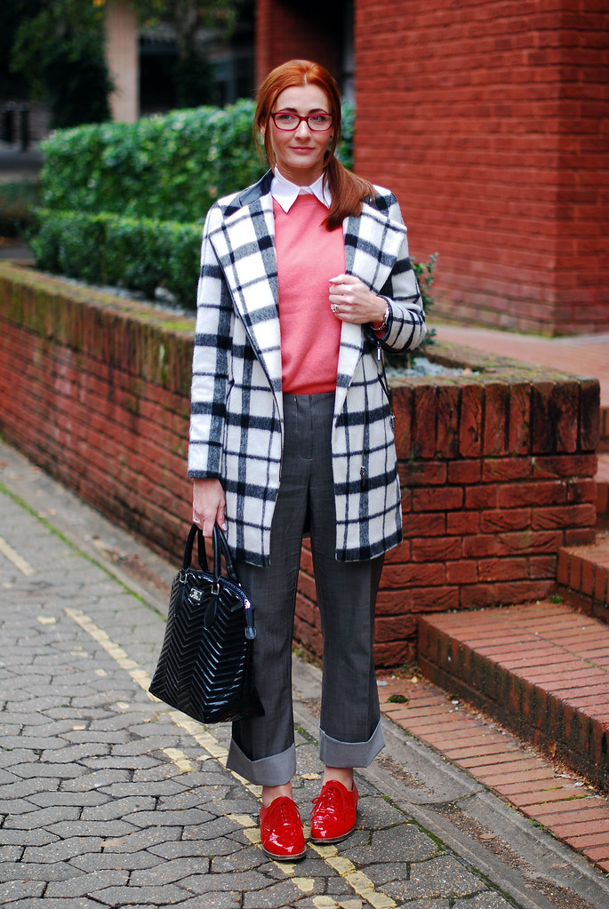 Black & white check coat, coral sweater, red brogues