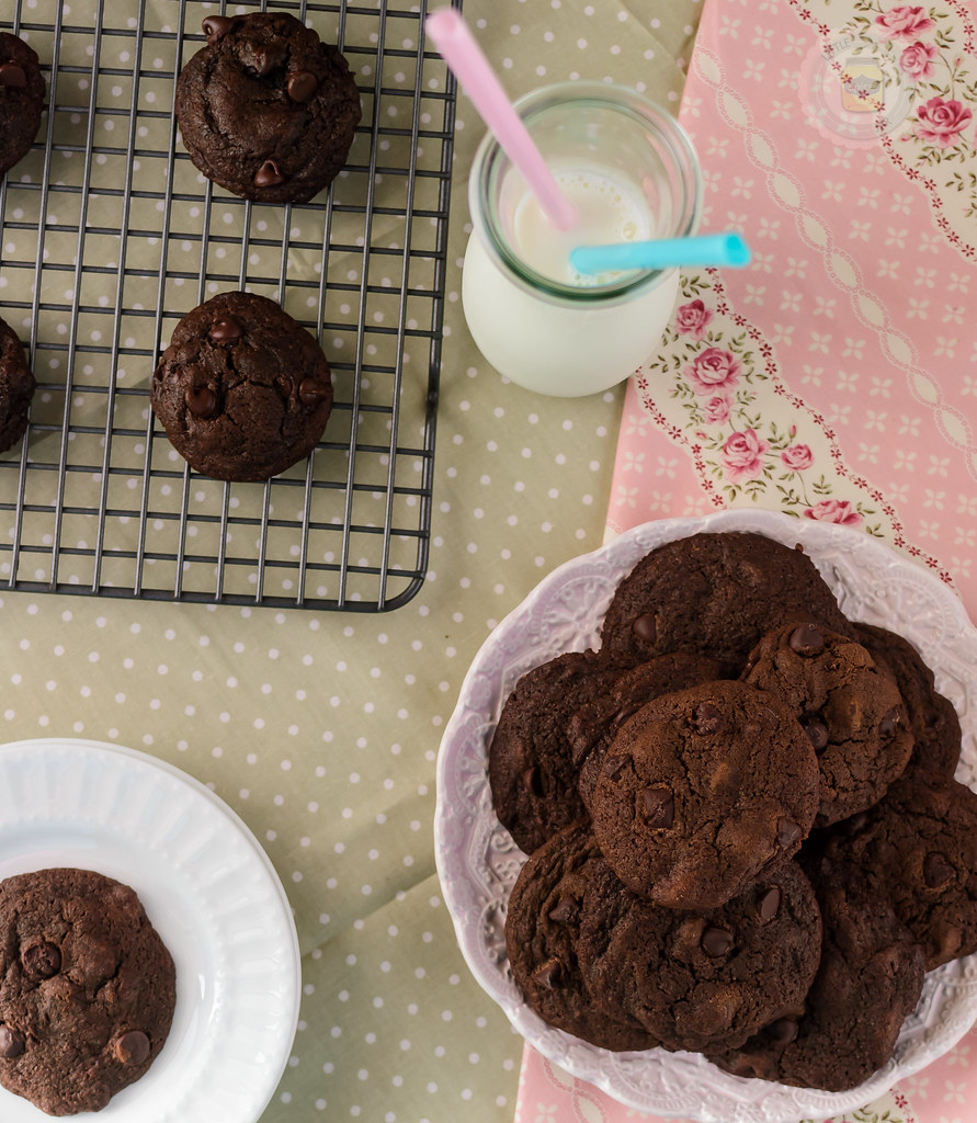 Espresso Double Chocolate Chip Cookies plated in pink bowl with milk in bottle with straws