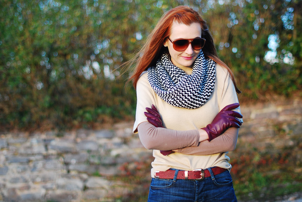 Layered knitwear with plum gloves