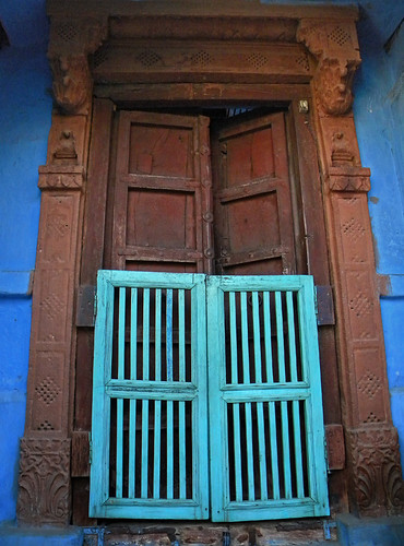 A turquoise gate on a red door in Jodhpur, India