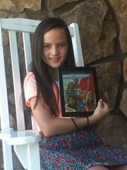 NMG member Athena reading NMG