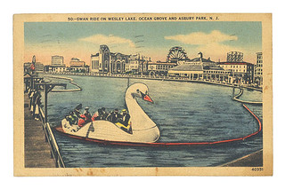 old postcard of swan boat on wesley lake