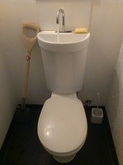 urinal(0.0), floor(1.0), toilet(1.0), room(1.0), plumbing fixture(1.0), tap(1.0), toilet seat(1.0), ceramic(1.0), bidet(1.0), bathroom(1.0), sink(1.0),