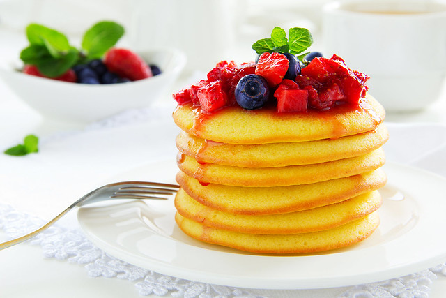 Pancakes with summer berries: strawberries, blueberries.
