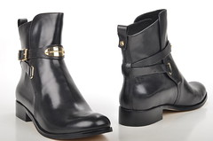 heel(0.0), outdoor shoe(0.0), limb(0.0), leg(0.0), human body(0.0), footwear(1.0), shoe(1.0), leather(1.0), motorcycle boot(1.0), boot(1.0),