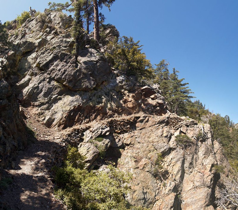 The rock-hewn Pacific Crest Trail on the north ridge of Apache Peak