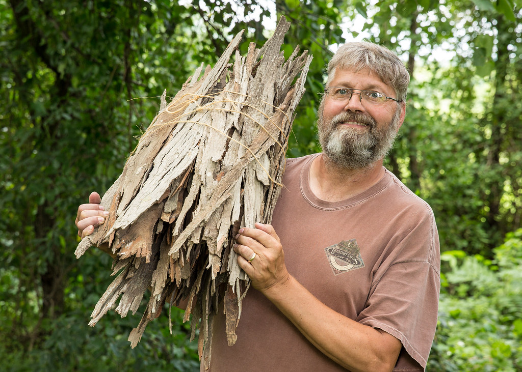 Travis Miller with Hickory bark from Falling Bark Farm Hickory Syrup in Berryville Virginia