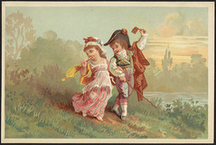 Man and woman walking in the countryside in historical costume. [front]
