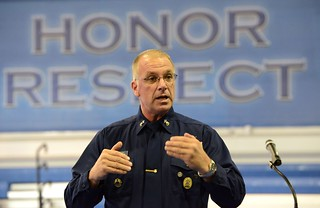 Master Chief Petty Officer Michael P. Leavitt, the 11th Master Chief Petty Officer of the Coast Guard, addresses Coast Guardsmen stationed aboard Training Center Cape May, N.J., during an all hands meeting Dec. 4, 2013. Leavitt, the Coast Guard's senior enlisted member, met with the Coast Guardsmen as part of a two-day visit to the Coast Guard's only enlisted basic training facility. Coast Guard photo by Seaman Jennifer Nease.