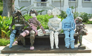 Five dolls and a bench