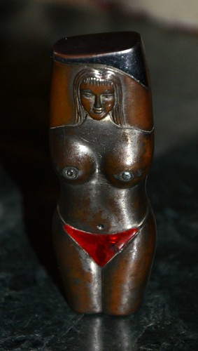bright nipples and bikini lighter from the 40s/50s - still lights up after so many years!