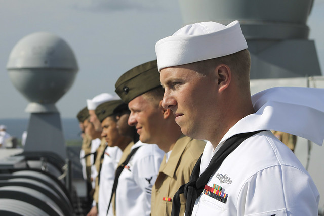 Sailors and Marines man the rails as USS Anchorage pulls in to Pearl Harbor