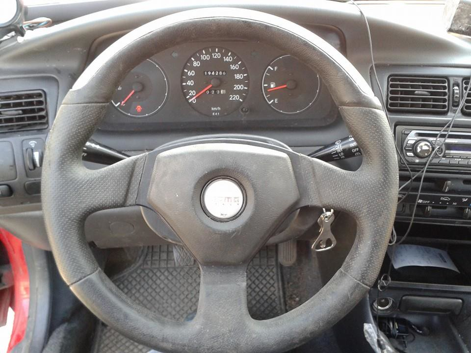 Aftermarket Momo steering wheel fitted in my EE101 hatch 13609510623_4920010d20_b
