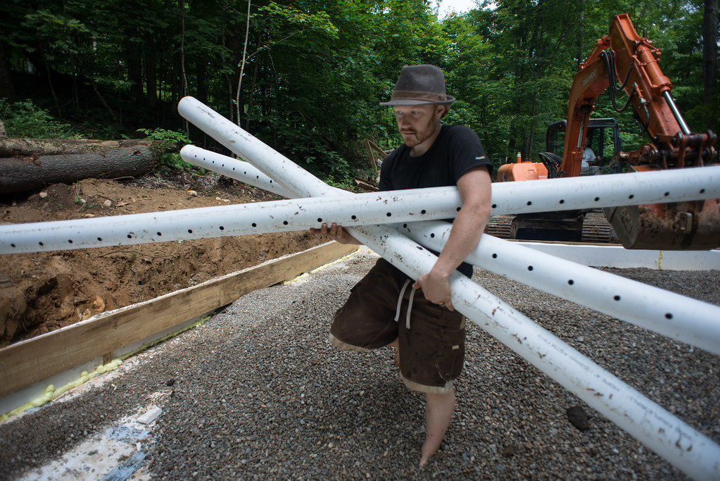 tyler carrying perforated drain pipe for french drain