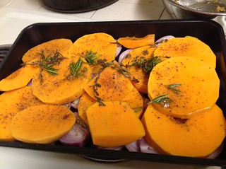 Bed of shallots and butternut for the pork loin, with pork marinade on it