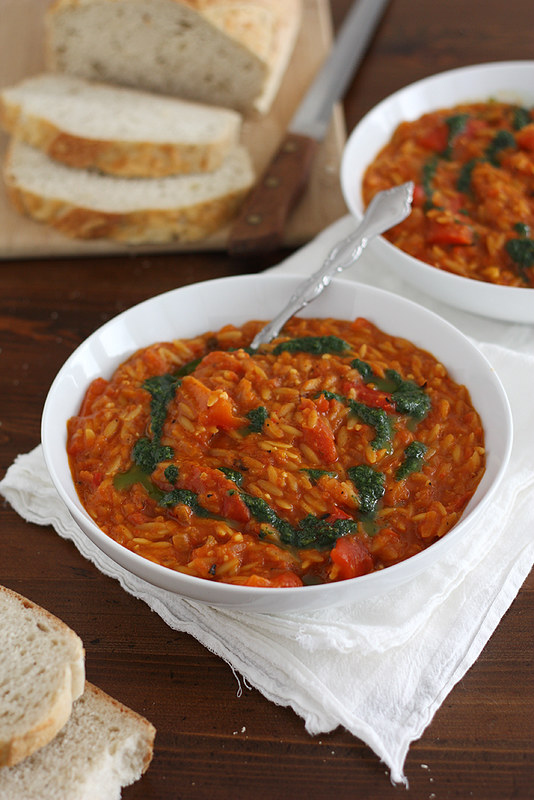 chunky red pepper soup with orzo and herb oil