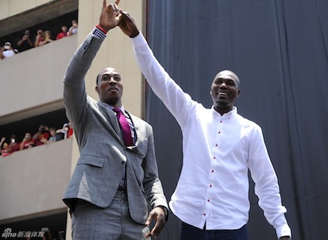 July 13, 2013 - Dwight Howard and Hakeem Olajuwon raise their hands to the crowd outside Toyota Center at Howard's welcome rally