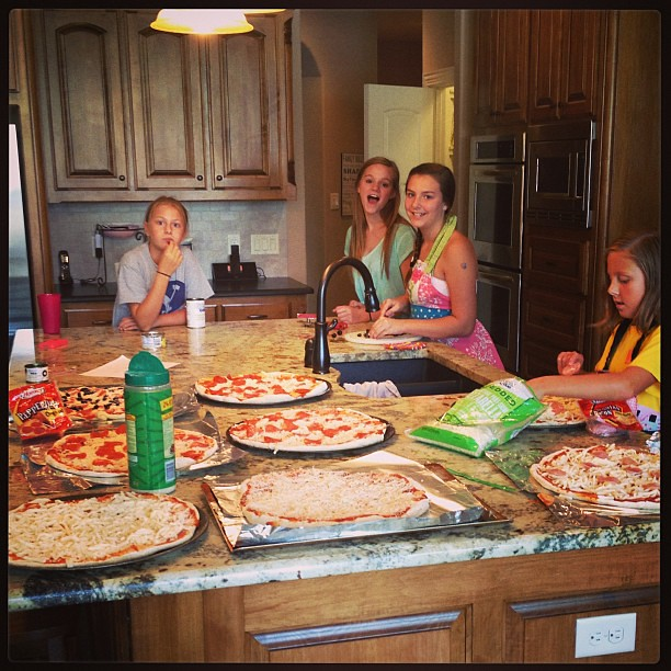 My helpers. We cranked out 8 homemade pizzas today!  Yummy!  Thanks
