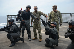 A U.S. Navy Maritime Civil Affairs and Security Training (MCAST) team exchanges best practices with a Royal Malaysian Navy boarding team during SEACAT in the South China Sea, Sept. 4. (U.S. Navy photo by Mass Communication Specialist 3rd Class Karolina A. Oseguera)