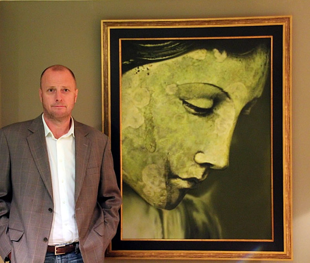 "Steve Murnaghan and his painting ""Angel in the Rain"""