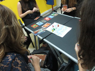 Playing a card game (Dixit)