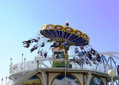 festival(0.0), resort(0.0), ferris wheel(0.0), dome(0.0), park(0.0), carnival(1.0), recreation(1.0), outdoor recreation(1.0), landmark(1.0), vacation(1.0), carousel(1.0), amusement ride(1.0), amusement park(1.0),