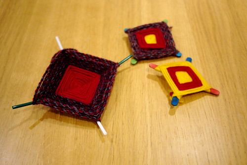 "Modern day versions of the ""diamond"" type of cross shown above. These were made using lollipop sticks or straws with wool woven around them. As E Estyn Evans notes they are very similar to charms from other countries such as the Mexican"