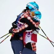 Marielle Thompson and Kelsey Serwa embrace after finishing 1 & 2 at the Olympic Winter Games in Sochi, RUS