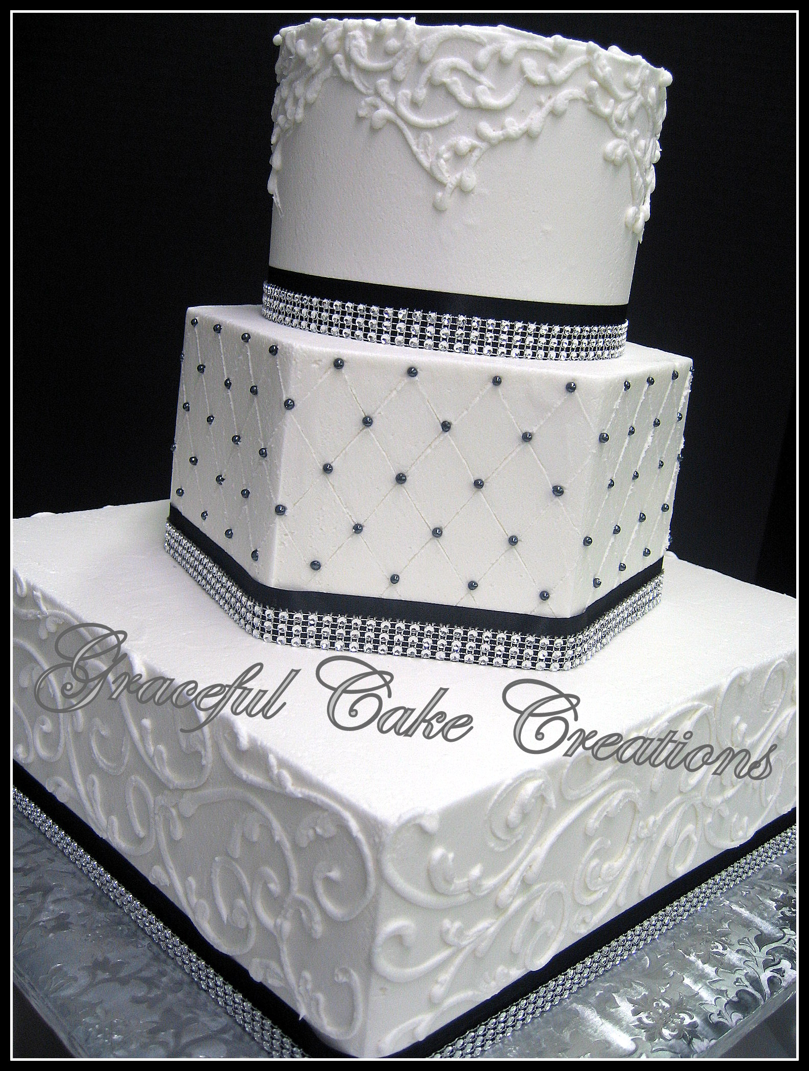 Elegant White Wedding Cake with Black Ribbon and Bling