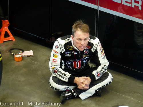 Kevin Harvick sits in the garage by