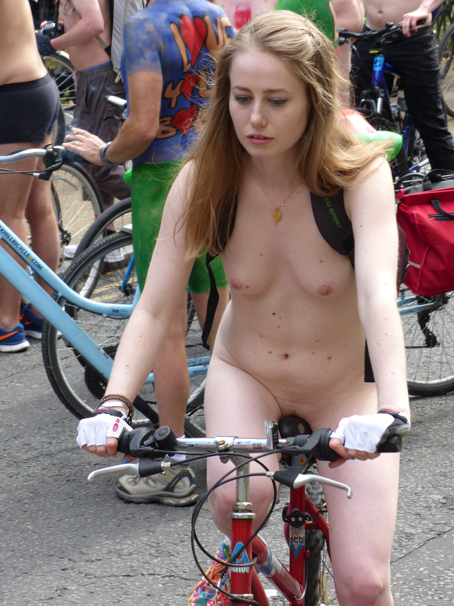 Girls ride naked bike