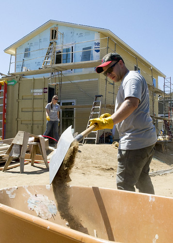 SAN DIEGO - Master-at-Arms 1st Class Raul Cabin, assigned to the USS America (LHA 6), clears loose dirt at Habitat for Humanity's Home Builders Blitz, an initiative to build four homes in five days.