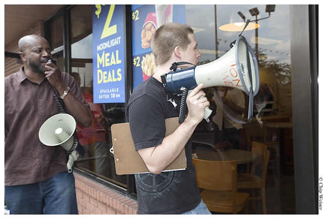 Dustin Ponder and Calvin Johnson-organizers-walk out of Wendy's with bullhorns