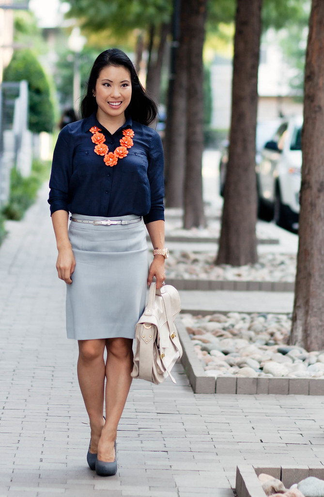 navy camp button down shirt, light gray dusk pencil skirt, orange bloom flower bib necklace outfit #ootd