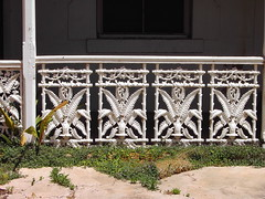 Beautiful fern pattern wrought iron lacework on old cottage in Main Street of Moonta South Australia. The old copper mining town.