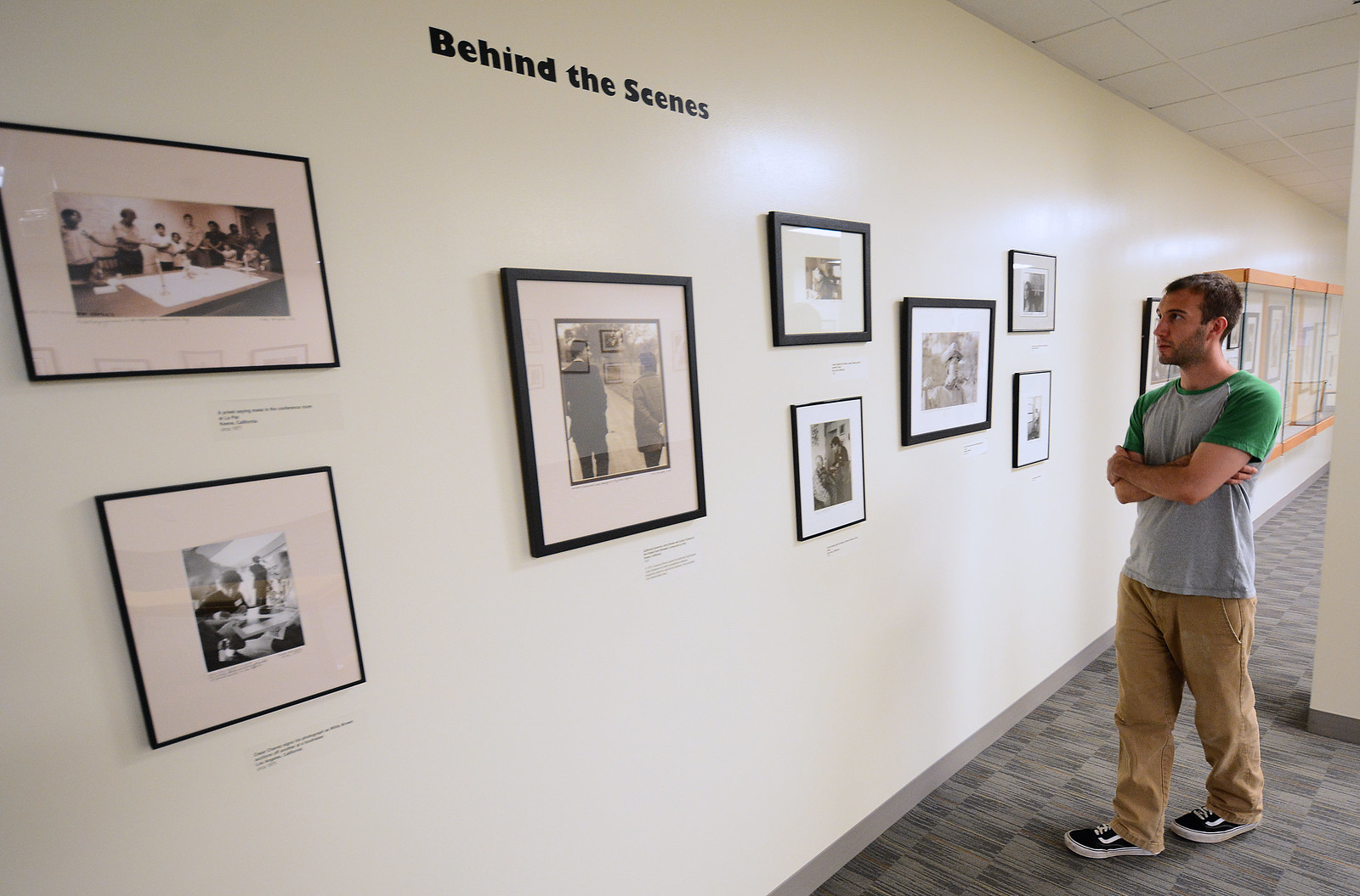 Andrew Dercole, senior, observes photographs in the Marching Through History with Cesar Chavez and the Farm Workers exhibit at J. Paul Leonard Library on Monday, Sept. 16, 2013. Photo By Philip Houston / Xpress