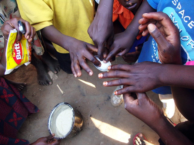 Kabermaido people touching finished soap